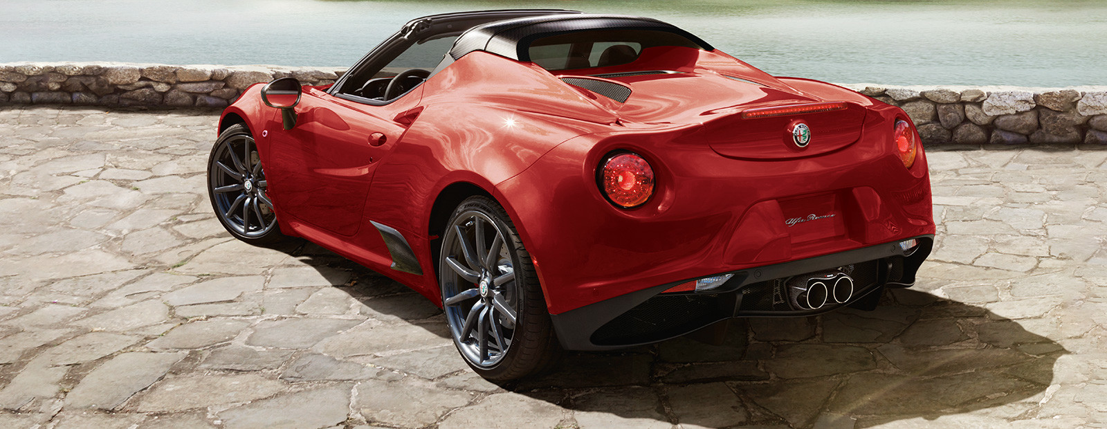 Alfa-Romeo-4C-spider-rear-side-profile-with-red-exterior_expanded_ba975595897a4e8b6312a4fb967ce540-1600x620_2019-09-17.jpg